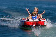Megan Roemer and her daughter Elke enjoy an afternoon of tubing near Chambers Island.  (Mike Roemer Photo)