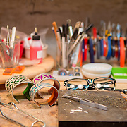 Workstation detail at jewelry designer Gogo Borgerding's studio and store in the Lower Garden District in New Orleans. For more information, visit: http://www.ilovegogojewelry.com