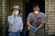 Eric Hollar, a member at Memorial Lutheran Church, Katy, Texas, helps other volunteers clear debris from a home damaged by Hurricane Harvey at a home near the church on Friday, Sept. 1, 2017, in Katy. LCMS Communications/Erik M. Lunsford