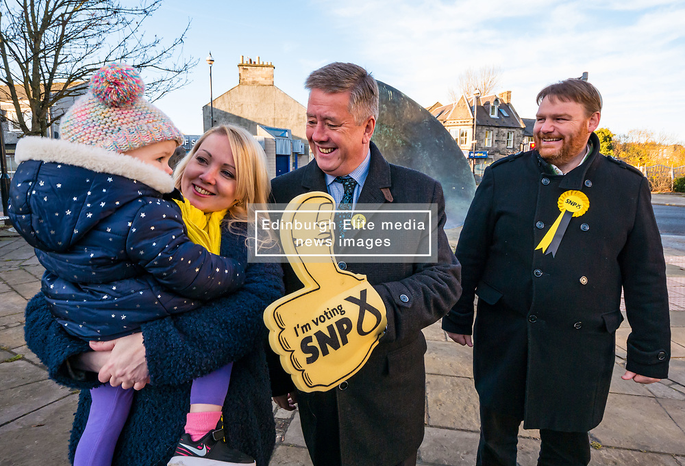 Kelly and Isla (nearly 2years), wife & daughter of Owen Thompson, Keith Brown, SNP Depute Leader and Owen Thompson<br /> <br /> Loanhead, Midlothian, Scotland, United Kingdom, 18 November 2019. General Election campaigning:  SNP Depute Leader Keith Brown MSP joins Owen Thomson, SNP candidate for Midlothian, on the campaign trail at Fountain Green, Loanhead.<br /> Sally Anderson | EdinburghElitemedia.co.uk