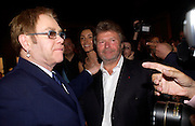Sir Elton John and Alain-Dominique Perrin. 4 Inches, A  Photographic Auction in aid of the Elton John Aids Foundation hosted by Tamara Mellon and Arnaud Bamberger. Christie's. 8 King St. London. 25 May 2005. ONE TIME USE ONLY - DO NOT ARCHIVE  © Copyright Photograph by Dafydd Jones 66 Stockwell Park Rd. London SW9 0DA Tel 020 7733 0108 www.dafjones.com