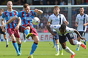 Jack King  clears ball from Steve Morison  during the Sky Bet League 1 match between Scunthorpe United and Millwall at Glanford Park, Scunthorpe, England on 22 August 2015. Photo by Ian Lyall.