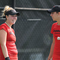 Georgia's Maria Gould, left, and Silvia Garcia during a match Saturday September 13, 2014 at UNCW. (Jason A. Frizzelle)