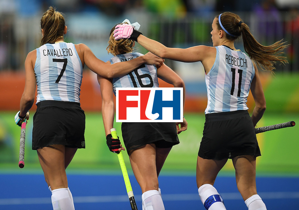 Argentina's Florencia Habif (C) celebrates scoring a goal with teammates during the women's field hockey Britain vs Argentina match of the Rio 2016 Olympics Games at the Olympic Hockey Centre in Rio de Janeiro on August, 10 2016. / AFP / MANAN VATSYAYANA        (Photo credit should read MANAN VATSYAYANA/AFP/Getty Images)