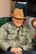 Couple watching Miles City Bucking Horse Sale Parade, Montana
