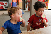 Two year baby boys eat icecream