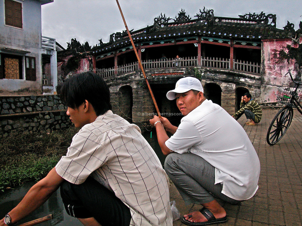 Vietnam, Hoi An:fishing in the channel naer the japanese bridge.
