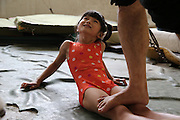 NANNING, CHINA - JUNE 17: (CHINA OUT) <br /> <br /> Gymnastics Children In Nanning<br /> <br /> A teacher helps a girl stretch legs during a gymnastics training session at Nanning Sports School on June 17, 2013 in Nanning, Guangxi Province of China. <br /> ©Exclusivepix