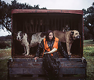 Ana Parreira, tracking dog handler. <br /> <br /> The pose and the prey.<br /> <br />  Hunting in my imagination was always more taxidermy photograph as if the prey was just a mere accessory of the hunter's pose - the real trophy.<br /> <br />  When I decided to document the daily lives of Portuguese hunters came instantly to the memory the &quot; clich&eacute; &quot; from the photographer JA da Cunha Moraes , captured during a hippopotamus hunt in the River Zaire , Angola, and published in 1882 in the album Africa Occidental . The white hunter posed at the center of the photograph , with his rifle , surrounded by the local tribe.<br /> <br />  It was with this clich&eacute; I went to Alentejo, south of Portugal, in search of the contemporary hunters . For several months I saw deer, wild boar, foxes. I photographed popular hunting  and private hunting estates , wealthy and middle class hunters, meat hunters and trophy hunters . I photographed those who live from hunting and those who see it as a hobby for a few weekends during the year . I followed the different times and moments of a hunt , in between the prey and the pose , wine and blood, the crack of gunfire and the murmur of the fields .<br /> <br />  I was lucky , I heard lots of hunting stories. I found an essentially old male population , where young people are a minority . Hunters, a threatened species by ageing and loss of economic power caused by the crisis in the South of Europe.<br /> <br />  The result of this time is this series of images, distant from the &quot;cliche&quot; , from 1882.