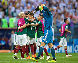 MOSCOW, RUSSIA - Sunday, June 17, 2018: Germany's goalkeeper Manuel Neuer pulls of his shirt in dejection as Mexico players celebrate a 1-0 victory during the FIFA World Cup Russia 2018 Group F match between Germany and Mexico at the Luzhniki Stadium. (Pic by David Rawcliffe/Propaganda)
