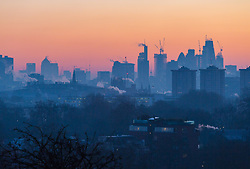 London, December 12 2017. The city's skyscraper against the pastel tones of the sky before sunrise on a clear very cold morning in London, seen from Primrose Hill in Camden. © Paul Davey
