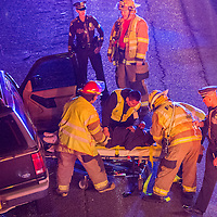 110113       Cable Hoover<br /> <br /> New Mexico State Police officers and Gallup Fire personnel pull one victim from her car at the scene of a crash on east bound Interstate 40 Friday.