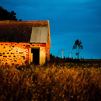 Small building on farmland