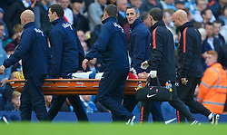 MANCHESTER, ENGLAND - Sunday, November 2, 2014: Manchester United's Marcos Rojo is stretchered off with a dislocated shoulder injury during the Premier League match against Manchester City at the City of Manchester Stadium. (Pic by David Rawcliffe/Propaganda)