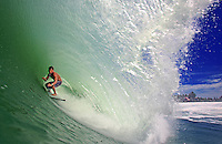 Local surfer deep in the barrel at Lagundri Bay