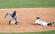 June 2, 2010; Birmingham, AL, USA; Tennessee Smokies short stop TOny Thomas (3) receives the throw from the catcher as Birmingham Barons Buck Coats (23) slides safely into second during the 15th Annual Rickwood Classic at Rickwood Field. Mandatory credit  Marvin Gentry