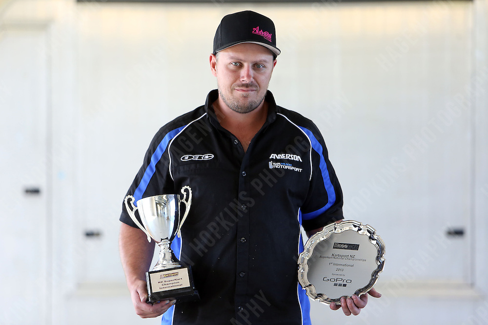 Karl Wilson poses with the winners' trophy and plate during the 2013 Superkart National Champs and Grand Prix at Manfeild in Feilding, New Zealand on Saturday, 5 January 2013. Credit: Hagen Hopkins.