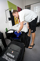 Matjaz Vezjak preparing jerseys and towels for Slovenian team in a Andel's Hotel during Eurobasket 2009, on September 15, 2009 in  Lodz, Poland.  (Photo by Vid Ponikvar / Sportida)