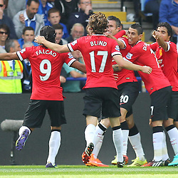 Manchester United players congratulate Manchester United's Robin Van Persie after his goal during the Barclays Premiership match between Leicester City FC and Manchester United FC, at the King Power Stadium, Leicester, 21st September 2014 © Phil Duncan | SportPix.org.uk