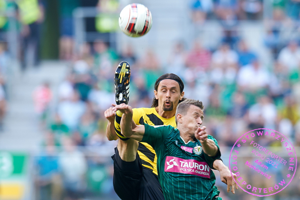 (R) Tomasz Holota of Slask Wroclaw fights for the ball with (L) Neven Subotic of Dorussia Dortmund during international friendly soccer match between WKS Slask Wroclaw and BVB Borussia Dortmund on Municipal Stadium in Wroclaw, Poland.<br /> <br /> Poland, Wroclaw, August 6, 2014<br /> <br /> Picture also available in RAW (NEF) or TIFF format on special request.<br /> <br /> For editorial use only. Any commercial or promotional use requires permission.<br /> <br /> Mandatory credit:<br /> Photo by &copy; Adam Nurkiewicz / Mediasport