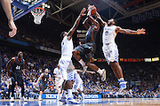 LEXINGTON, KY - DECEMBER 5: Aaron Harrison #2 of the Kentucky Wildcats blocks a shot by Kendal Yancy #0 of the Texas Longhorns during the game at Rupp Arena on December 5, 2014 in Lexington, Kentucky. The Wildcats defeated the Longhorns 63-51. (Photo by Joe Robbins)