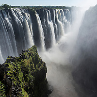Africa, Zimbabwe, Victoria Falls National Park, Zambezi River as it flows over Victoria Falls