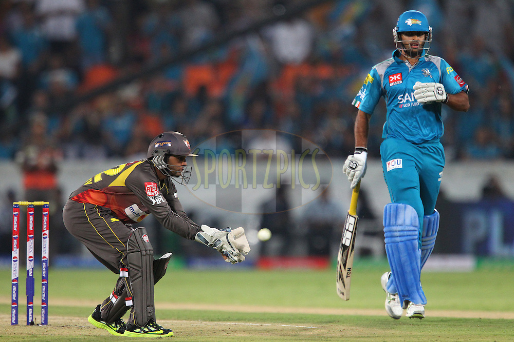 Parthiv Patel gathers the ball during match 3 of of the Pepsi Indian Premier League between The Sunrisers Hyderabad and The Pune Warriors held at the Rajiv Gandhi International  Stadium, Hyderabad  on the 5th April 2013..Photo by Ron Gaunt-IPL-SPORTZPICS..Use of this image is subject to the terms and conditions as outlined by the BCCI. These terms can be found by following this link:..http://www.sportzpics.co.za/image/I0000SoRagM2cIEc