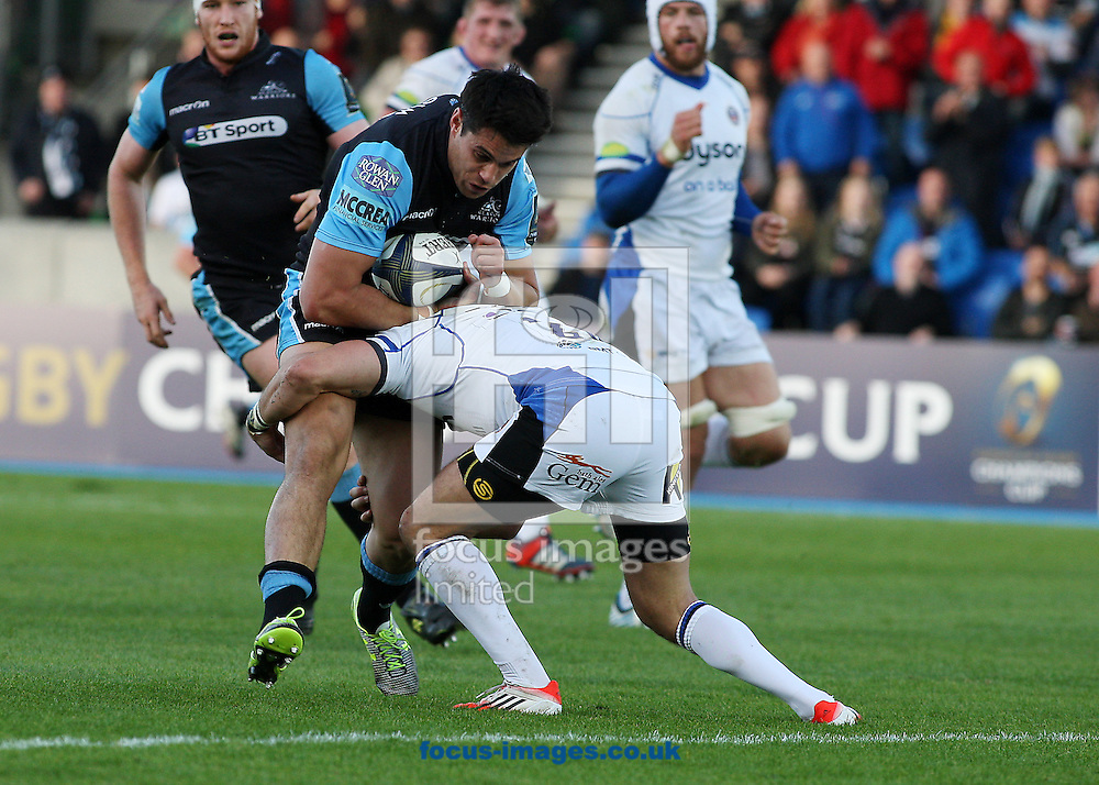 Sean Maitland of Glasgow Warriors and Horacio Agulla of Bath Rugby during the European Rugby Champions Cup match at Scotstoun Stadium, Glasgow<br /> Picture by Ian Buchan/Focus Images Ltd +44 7895 982640<br /> 18/10/2014