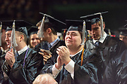 Students applaud the commencement speaker at spring undergradute commencement. Photo by Ben Siegel