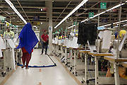 A lady sweeping the floor inside Epyllion Group garment factory in Bangladesh.