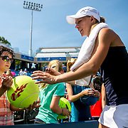 August 25, 2016, New Haven, Connecticut: <br /> Johanna Larsson of Sweden signs autographs for fans after winning a match against Roberta Vinci of Italy on Day 7 of the 2016 Connecticut Open at the Yale University Tennis Center on Thursday, August  25, 2016 in New Haven, Connecticut. <br /> (Photo by Billie Weiss/Connecticut Open)