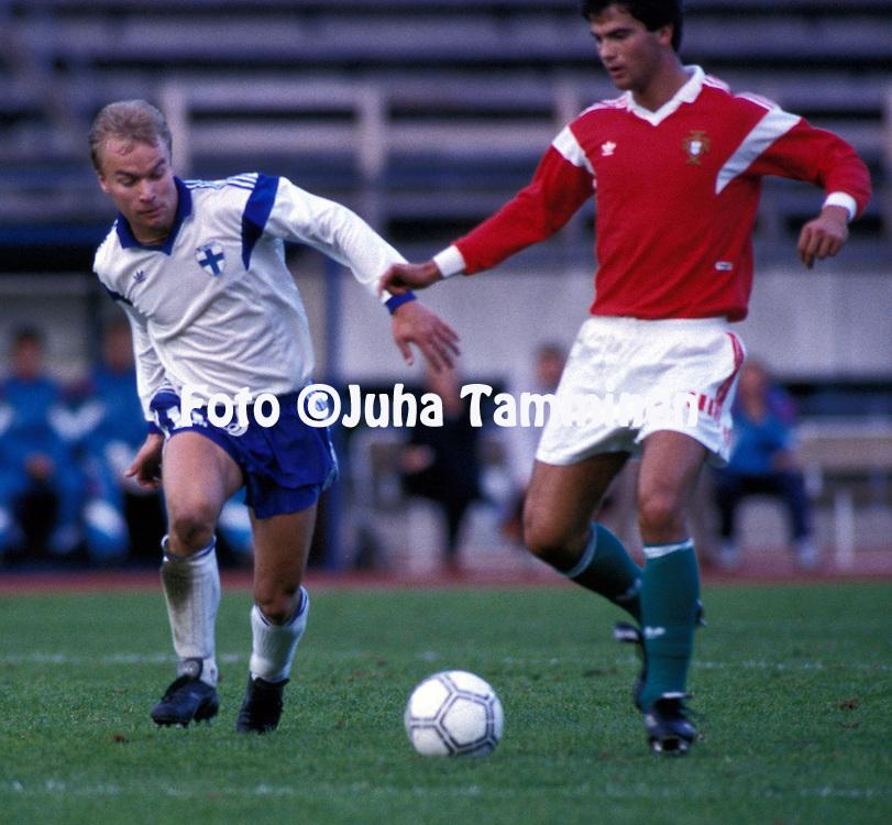 11.09.1990, Lahti, Finland..UEFA Under-21 European Championship Qualifying Match, Finland v Portugal. .Kaarlo Kankkunen (Finland U-21) v Fernando Couto (Portugal U-21).©Juha Tamminen
