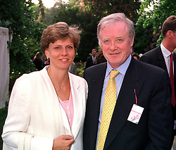 MR & MRS GERRY ROBINSON he is chief executive of Granada Group PLC,<br />  at the Chelsea Flower show in London on 22nd May 2000.OEJ 47