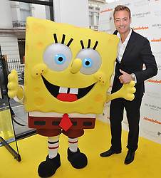CHARLEY SPEED and SpongeBob SquarePants at a party to launch a range of SpongeBob SquarePants suits and accessories designed by Richard James in partnership with Nickelodeon held at Richard James, 29 Savile Row, London W1 on 11th May 2011.