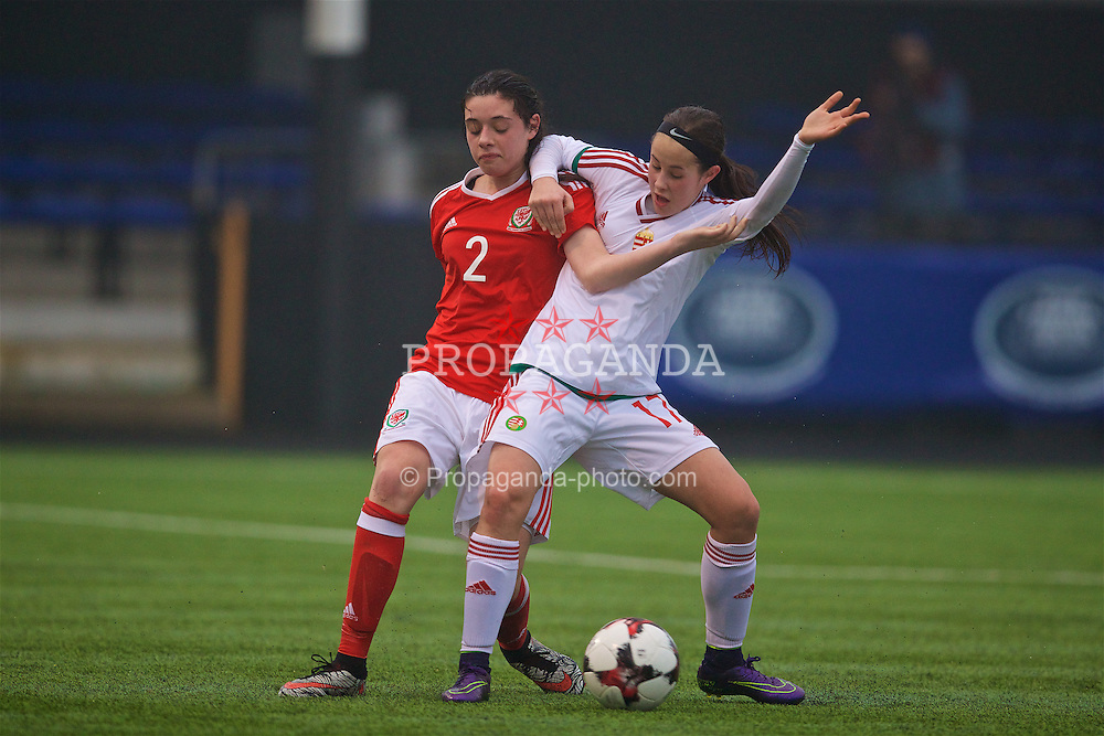 MERTHYR, WALES - Tuesday, February 14, 2017: Wales' Thierry-Jo Gauvain in action against Hungary's Pintye Vivien during a Women's Under-17's International Friendly match at Penydarren Park. (Pic by Laura Malkin/Propaganda)