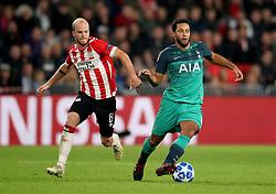 PSV Eindhoven's Jorrit Hendrix (left) and Tottenham Hotspur's Mousa Dembele (right) battle for the ball
