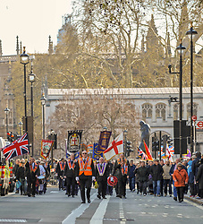 Orange men of the Orange order march along Whitehall to lay wreaths at the Cenotaph London.<br /> <br /> Richard Hancox | EEm 13042019