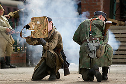 "Reenactors from Northern World War Two Association, portraying a members of the 1st Fallschirmjaeger Division 'The Green Devils' take part in a firing display with a Panzerschreck or ""tank terror"" at Elsecar 1940s Weekend<br />
