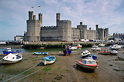 Boats moored near Caernarfon Castle, Wales