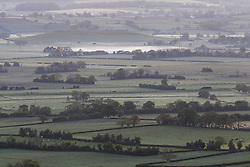 © Licensed to London News Pictures. 20/05/2015. Glastonbury, UK. Patchy mist on the Somerset levels before sunrise seen from Glastonbury Tor this morning, 20th May 2015. The day has started off clear, with early morning temperatures near freezing in places in the south west of England. Photo credit : Rob Arnold/LNP