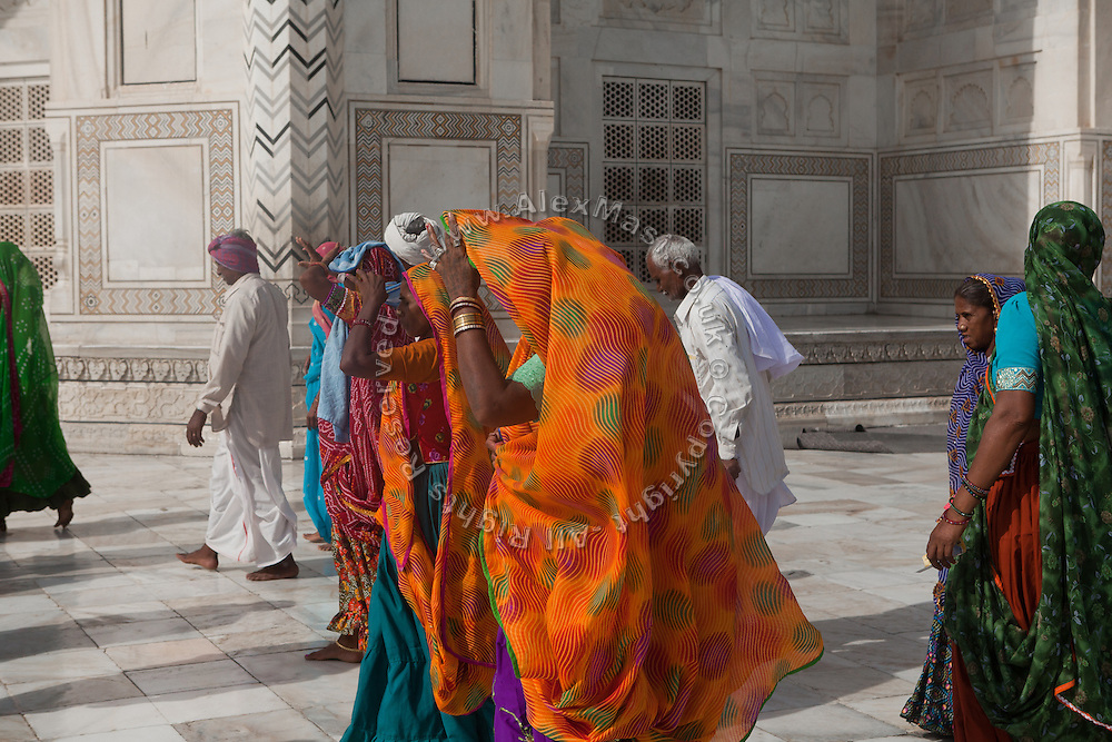 Women are adjusting their saris inside the main complex of the Taj Mahal, in Agra.
