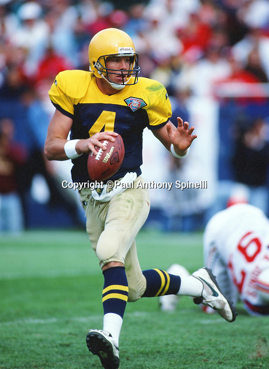 Green Bay Packers quarterback Brett Favre (4) rolls out as he looks to throw a pass during the NFL football game against the New England Patriots on Oct. 2, 1994 in Foxborough, Mass. The Patriots won the game 17-16. (©Paul Anthony Spinelli)
