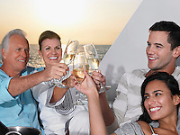Young and middle-aged couple relaxing on yacht toasting with champagne