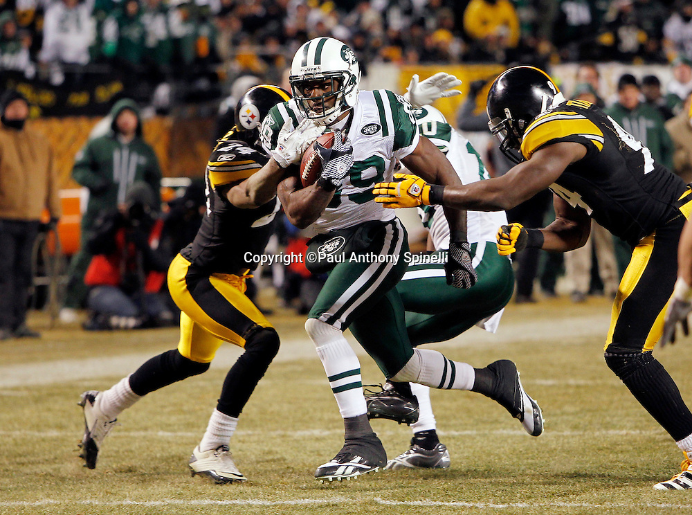 New York Jets wide receiver Jerricho Cotchery (89) catches a first down pass on third and one that gives the Jets first and goal during the fourth quarter of the NFL 2011 AFC Championship playoff football game against the Pittsburgh Steelers on Sunday, January 23, 2011 in Pittsburgh, Pennsylvania. The Steelers won the game 24-19. (©Paul Anthony Spinelli)