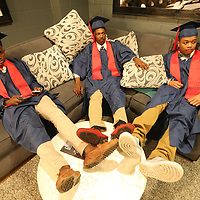 Nettleton graduating seniors Nashawn Pounds, Trenorris Hammond and Cortez Doss relax in a dressing room prior to their graduation ceremony as they watch a re-run of The NBA on TNT.