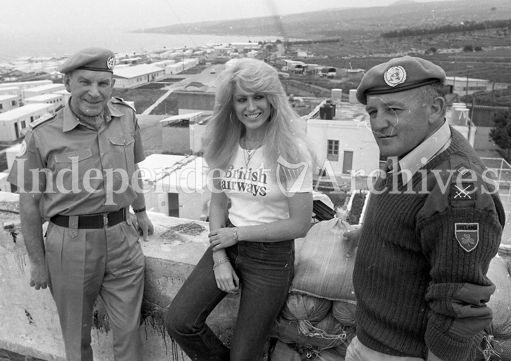 Geraldine Branigan with Col. Eamonn Quigley, Deputy Chief of Staff (left) and Lt. Col. Frank Whyte, Camp Commadant during her visit to Irish troops in the Lebanon. March 14, 1980.(Part of the Independent Newspapers/NLI Collection)