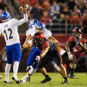 20 October 2018: San Diego State Aztecs linebacker Ronley Lakalaka (39) pressures San Jose State Spartans quarterback Josh Love (12) in second quarter. The Aztecs beat the Spartans 16-13 Saturday night at SDCCU Stadium.