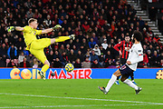 Aaron Ramsdale (12) of AFC Bournemouth gets away with a misskick as Mohamed Salah (11) of Liverpool bears down on him during the Premier League match between Bournemouth and Liverpool at the Vitality Stadium, Bournemouth, England on 7 December 2019.