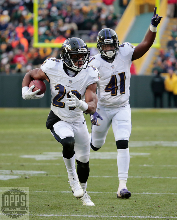 Baltimore Ravens defensive back Marlon Humphrey (29) intercepted Green Bay Packers quarterback Brett Hundley (7) pass late in the 4th quarter. Humphrey returned the ball to the Green Bay 3-yard line. <br /> The Green Bay Packers hosted the Baltimore Ravens at Lambeau Field Sunday, Nov. 19, 2017. The Packers lost 23-0. STEVE APPS FOR THE STATE JOURNAL.