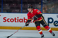 PENTICTON, CANADA - SEPTEMBER 8: Rasmus Andersson #54 of Calgary Flames skates with the puck against the Edmonton Oilers on September 8, 2017 at the South Okanagan Event Centre in Penticton, British Columbia, Canada.  (Photo by Marissa Baecker/Shoot the Breeze)  *** Local Caption ***